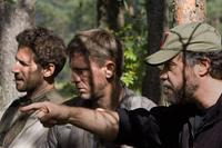 Director Edward Zwick, Daniel Craig and Mark Feuerstein on the set of