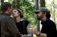 Director Edward Zwick, Daniel Craig and Alexa Davalos on the set of