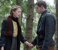 Mia Wasikowska as Chaya and Jamie Bell as Assael in