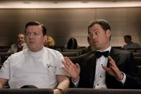 Ricky Gervais as Bertram Pincus and Greg Kinnear as Frank Herlihy in