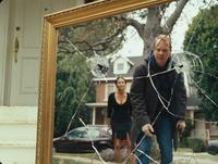 Kiefer Sutherland as Ben Carson and Amy Smart as Daisy Carson in
