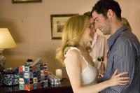 Heather Graham as Georgina and Tom Ellis as Zak in