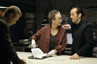 Oleg Stefan as Boris Fetyov, Kathleen Chalfant as Pam Frales and Denis O'Hare as Duke Monahan in