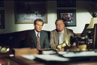 Josh Brolin as George W. Bush and Stacy Keach as Rev. Earle Hudd in