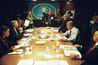 Director Oliver Stone (center), Thandie Newton as Condi Rice, Scott Glenn as Donald Rumsfeld, Bruce McGill as George Tenet, Josh Brolin as George W. Bush, Jeffrey Wright as Colin Powell and Richard Dreyfuss as Dick Cheney on the set of