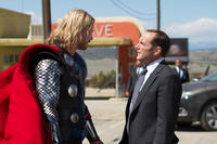 Chris Hemsworth as Thor and Clark Gregg as Agent Coulson in