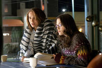 Natalie Portman as Jane Foster and Kat Dennings as Darcy Lewis in