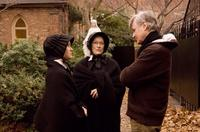 Amy Adams as Sister James, Meryl Streep as Sister Aloysius and John Patrick Shanley on the set of