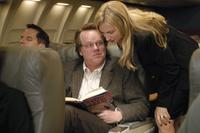 Philip Seymour Hoffman as Caden Cotard and Hope Davis as Madeleine Gravis in