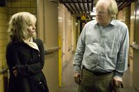 Jennifer Jason Leigh as Maria and Philip Seymour Hoffman as Caden Cotard in
