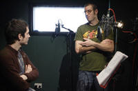 Elijah Wood and director Shane Ackner discuss a scene for