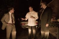 Matt Damon as Mark Whitacre, Tom Papa as Mick Andreas and Rick Overton as Terry Wilson in