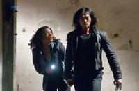 Naomie Harris as Mika and Rain as Raizo in