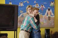 Jane Lynch as Sweeny and A.D. Miles as Martin Gary in