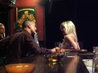 Jason Cottle as Russ and Tori Spelling as Susan in