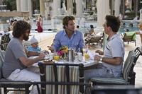 Zach Galifianakis as Alan, Baby Tyler, Bradley Cooper as Phil and Ed Helms as Stu in
