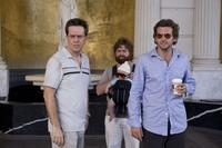 Ed Helms as Stu, Zach Galifianakis as Alan, Baby Tyler and Bradley Cooper as Phil in