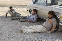 Ed Helms as Stu, Bradley Cooper as Phil and Zach Galifianakis as Alan in