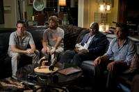 Ed Helms as Stu, Zach Galifianakis as Alan, Mike Tyson as himself and Bradley Cooper as Phil in