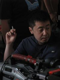 Director Jia Zhang Ke on the set of