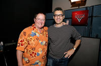 John Lasseter and John Turturro on the set of
