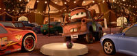 Lightning McQueen voiced by Owen Wilson, Mater voiced by Larry the Cable Guy and Sally voiced by Bonnie Hunt in