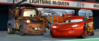 Mater voiced by Larry the Cable Guy and Lightning McQueen voiced by Owen Wilson in