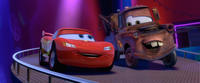 Lightning McQueen voiced by Owen Wilson and Mater voiced by Larry the Cable Guy in