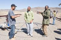 Directors Albert Hughes, Allen Hughes and Denzel Washington on the set of
