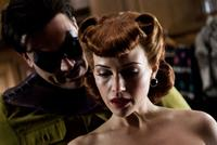 Jeffrey Dean Morgan as The Comedian and Carla Gugino as Silk Spectre in