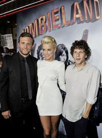 Director Ruben Fleischer, Amber Heard and Jesse Eisenberg at the California premiere of