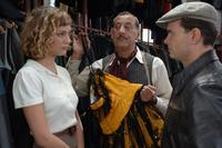 Nora Arnezeder as Douce and Clovis Cornillac as Milou in