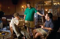 Seth Rogen, Writer/director/producer Judd Apatow and Adam Sandler on the set of