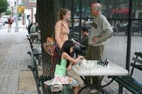 Evan Rachel Wood as Melody, Willa Cuthrell Tuttleman as Chess Girl and Larry David as Boris in