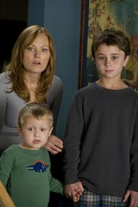 Malin Akerman as Ronnie, Colin Baiocchi as Kevin and Gattlin Griffith as Robert in