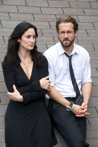 Carrie-Anne Moss and Ryan Reynolds in