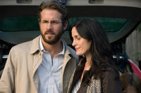Ryan Reynolds and Carrie-Anne Moss in