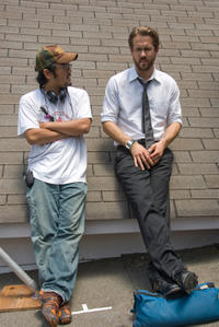Director/screenwriter Dennis Lee and Ryan Reynolds on the set of