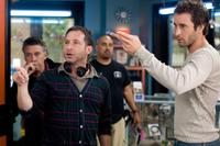 Director Alan Poul and Alex O'Loughlin on the set of