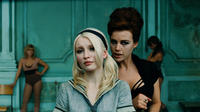 Emily Browning as Babydoll and Carla Gugino as Madam Gorski in