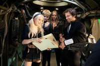 Emily Browning, Jena Malone, Abbie Cornish and director Zack Snyder on the set of