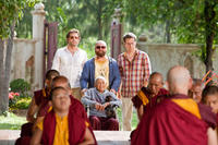 Bradley Cooper as Phil, Zach Galifianakis as Alan, Ed Helms as Stu and Aroon Seeboonruang as Monk in