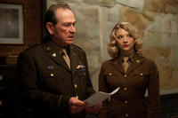 Tommy Lee Jones as Col. Chester Phillips and Natalie Dormer as Private Lorraine in