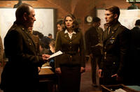 Tommy Lee Jones as Colonel Chester Phillips, Hayley Atwell as Peggy Carter and Chris Evans as Steve Rogers in