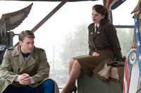 Chris Evans as Steve Rogers and Hayley Atwell as Peggy Carter in