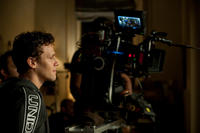Director Will Gluck on the set of