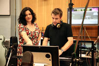 Director Sarah Smith works and composer Harry Gregson-Williams on the set of