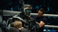 Dakota Goyo as Max, Atom and Hugh Jackman as Charlie Kenton in
