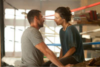 Hugh Jackman as Charlie Kenton and Evangeline Lilly as Bailey Tallet in