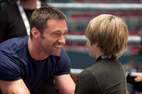 Hugh Jackman as Charlie Kenton and Dakota Goyo as Max in